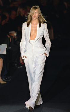 PARIS, FRANCE: A model presents a white ensemble by US designer Tom Ford during his first ready-to-wear show for Yves Saint Laurent (YSL) 13 October 2000 in Paris at the Spring/Summer 2001 ready-to-wear collections. (FILM) (Photo credit should read JEAN-PIERRE MULLER/AFP/Getty Images)